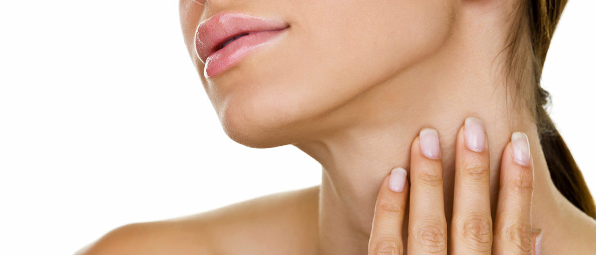 Close up of woman rubbing neck.