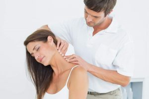 Man massaging woman's neck.
