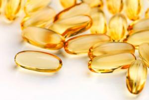Pile of yellow vitamin pills.