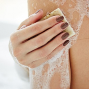Close up of woman washing her arm.