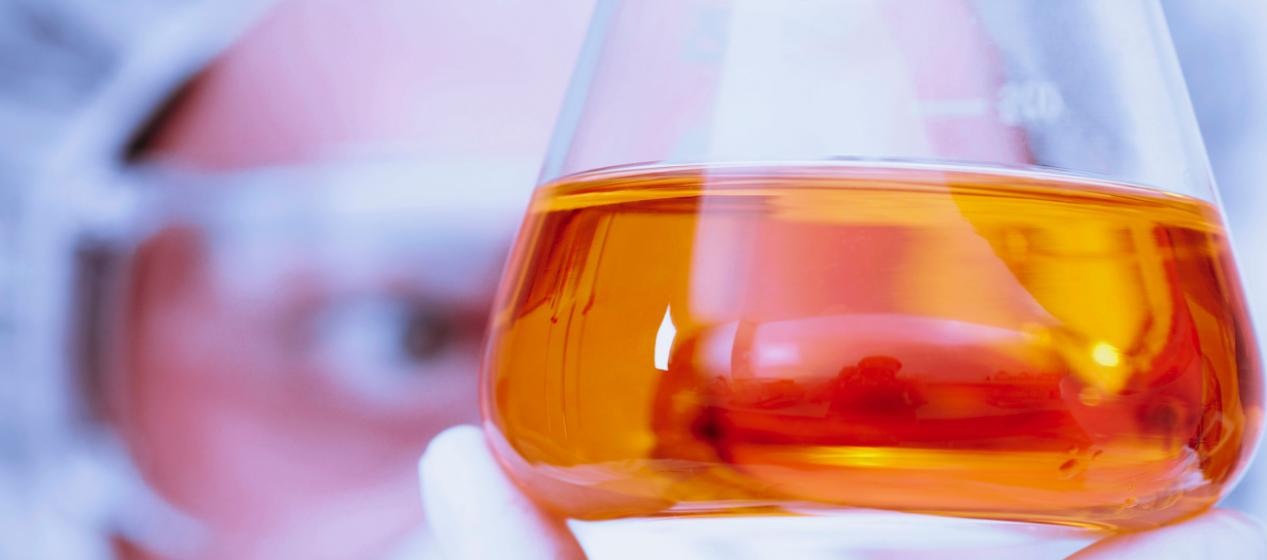 Close up of jug of orange liquid.