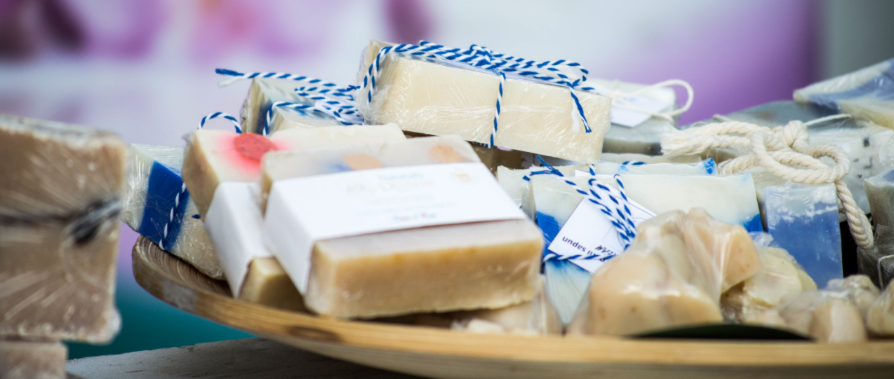 Soap bars tied with blue and white striped string.