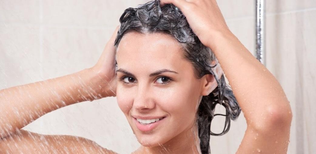 Woman shampooing hair.