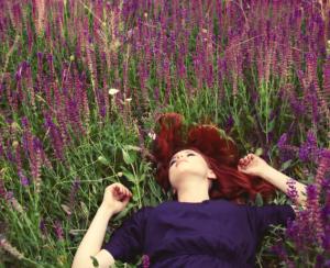 Woman lying in lavender field.
