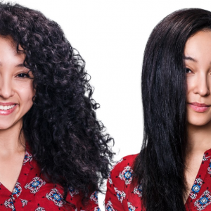 Woman with curly hair next to woman with straight hair.