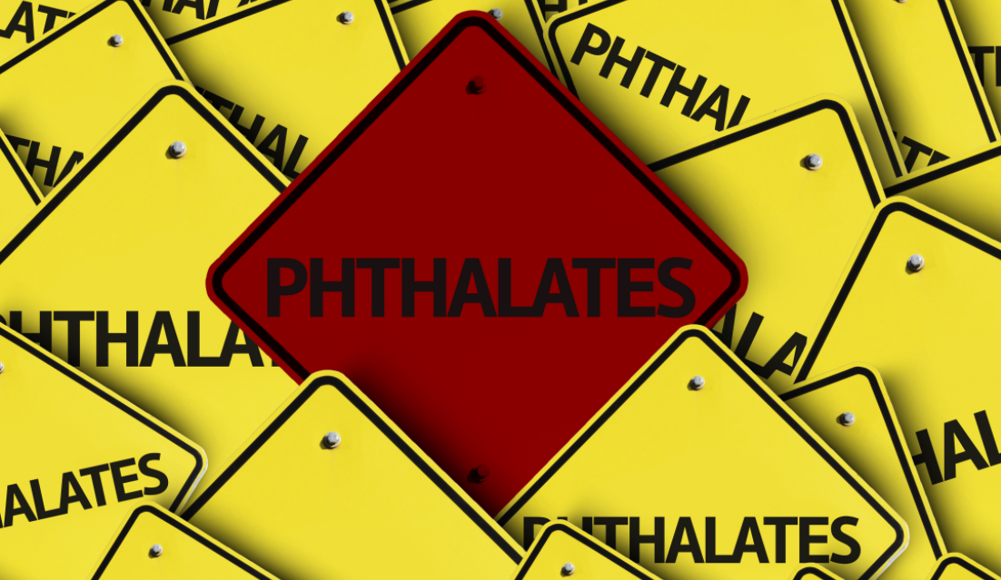 Yellow warning signs, with one red sign labeled 'pthalates'.