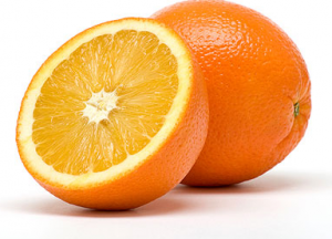 Orange next to sliced orange.