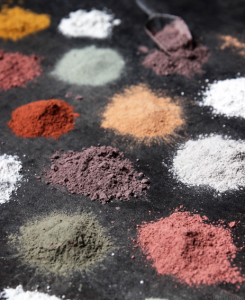 Piles of different colored powders.