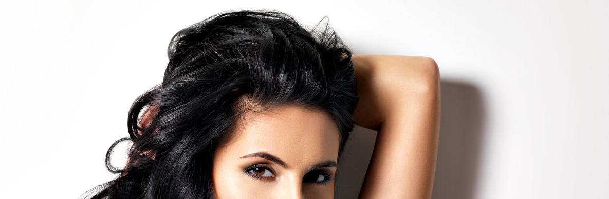 Top half of Woman's head with black hair.