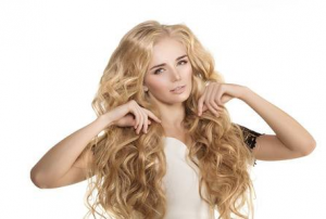 Woman with long, curly, blonde hair.