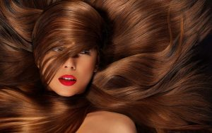 Woman surrounded by her own brown hair.