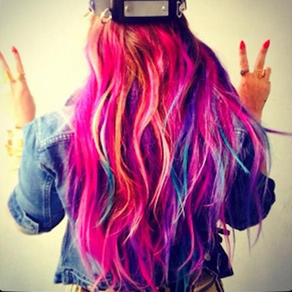 Back of woman's rainbow hair color.