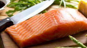 Salmon on cutting board.
