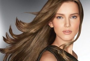 Woman with long sleek brown hair.