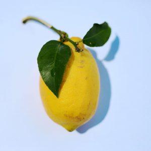 Lemon with blue background.