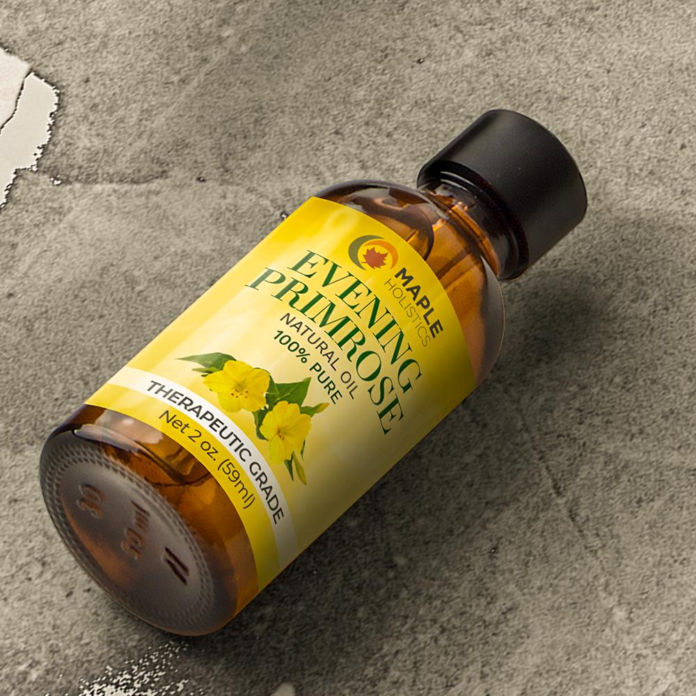 Bottle of evening primrose essential oil lying on carpet.