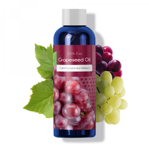 Bottle of grapeseed oil with grapes in the background.