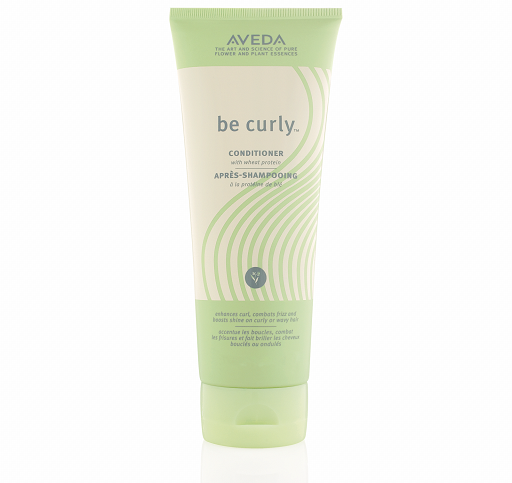 Bottle of Aveda Be Curly Conditioner.