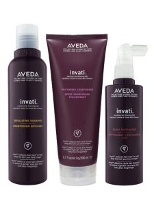 Aveda Invati hair care system product bottles.