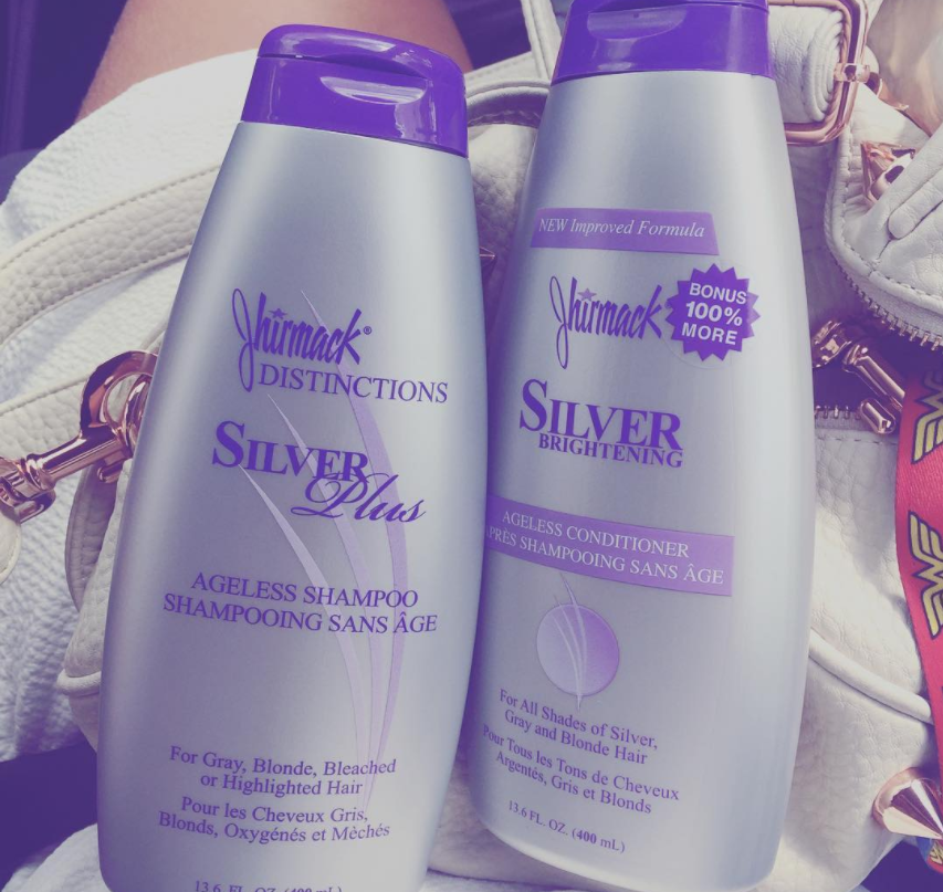 two silver and purple product bottles.
