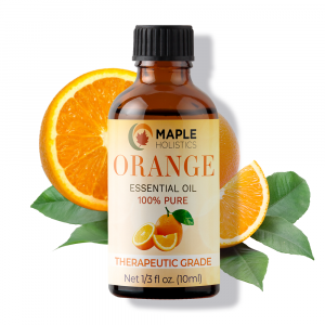 Bottle of orange essential oil with oranges in background.