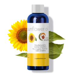 Bottle of sunflower oil with sunflower in background.