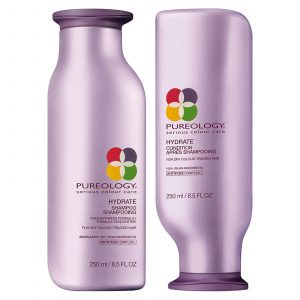 Pureology shampoo and conditioner product bottles.