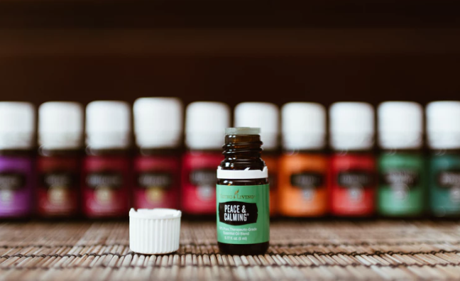 Tea tree oil with many oils in background.