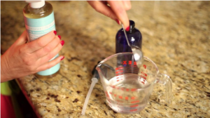 Woman pouring into measuring cup.