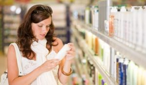 Woman looking at a product label.