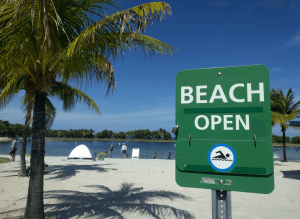 Open beach with sign.