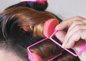 Pink foam rollers in hair.