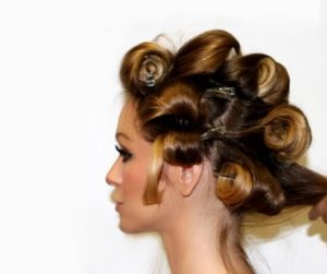 Pin curlers in woman's hair.
