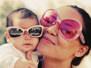 Mom and baby wearing sunglasses.