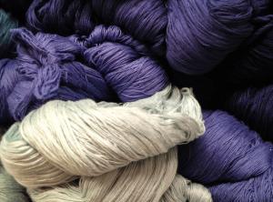White and purple yarn.