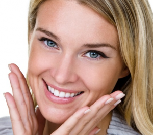 Woman smiling with clear skin.