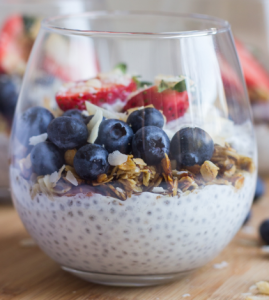 Chia seeds with Greek yogurt, blueberries, granola, almonds and strawberries.