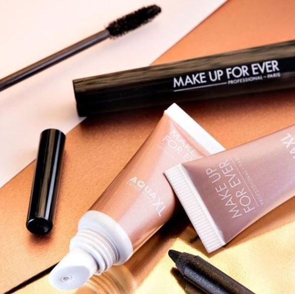 An assortment of make up for ever products.