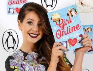 Zoella holding her book
