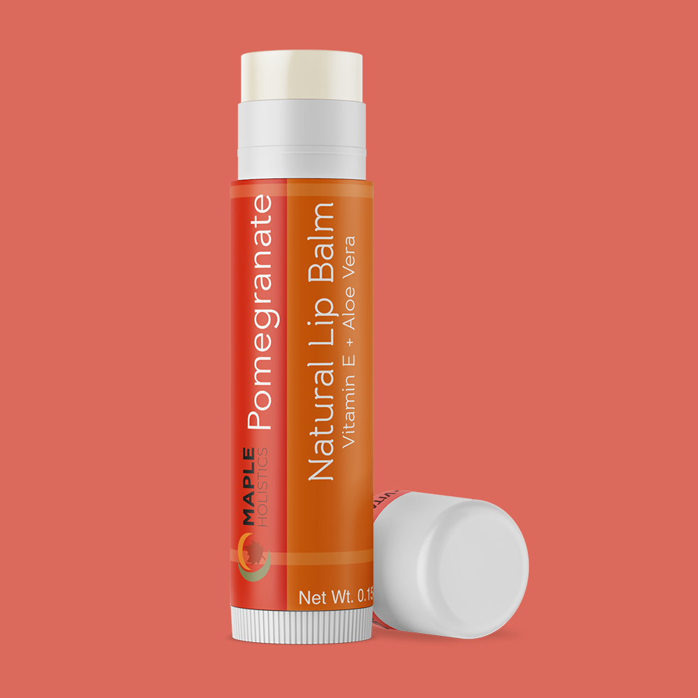 Open pomegranate lip balm with lid on the side.