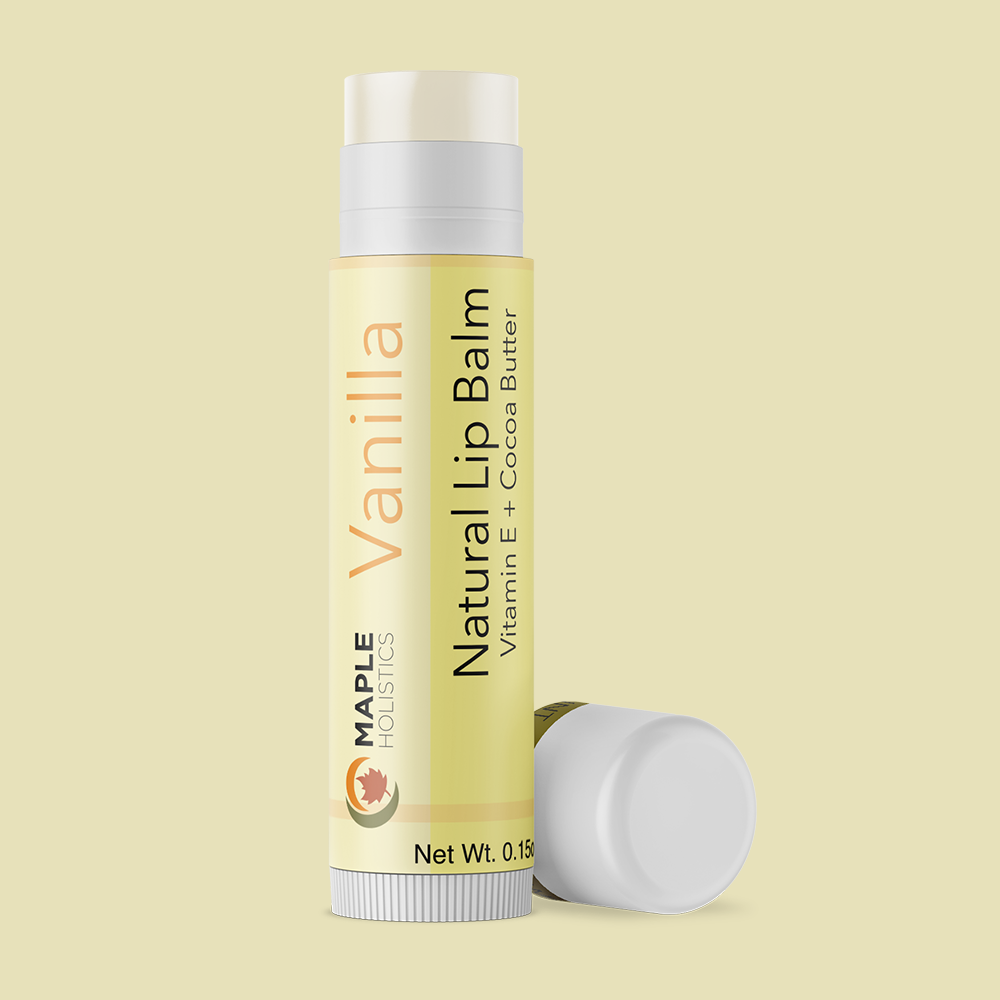 Open vanilla lip balm with lid on the side.