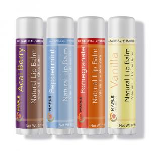 Four Maple Holisitcs lip balms in a row.