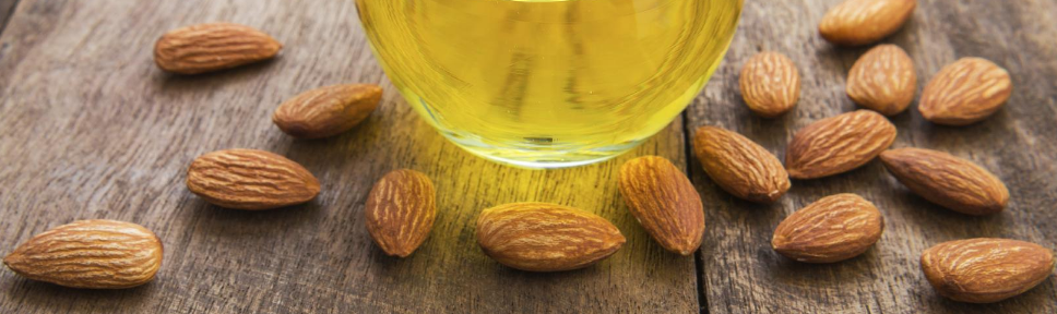 Almonds and a jar of oil