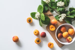 Apricots in a ball and on a table