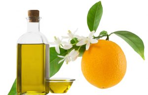 Neroli essential oil and an orange.
