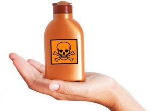 Woman holding toxic labeled bottle.
