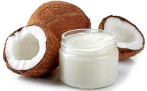 Coconut oil and cocnuts split open.