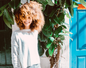 Girl smiling with curly hair