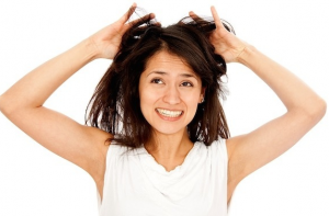 WOman tugging at her hair.