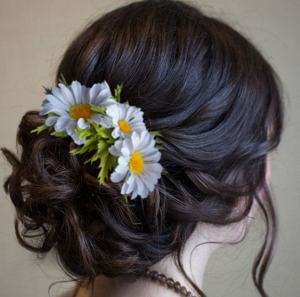 Woman's hair with flowers in bun.